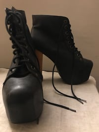 pair of black suede chunky heeled booties.  Jeffrey Campbell  brand seize 7M Los Angeles, 90038