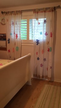 white, pink, and purple floral tab top curtains