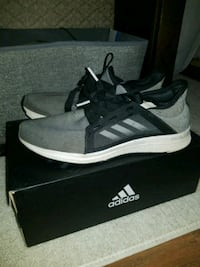 pair of gray Adidas low top sneakers on box St. Catharines, L2M
