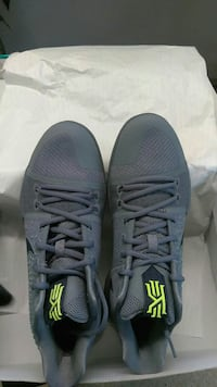 pair of gray Nike Kyrie basketball shoes
