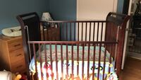 Baby's brown wooden crib obo Caledon