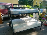 black metal bunk bed and gray floral mattresses Crystal
