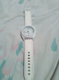 round white analog watch with white leather strap