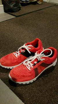 pair of red-and-white Reebok running shoes Edmonton, T5Z 0K1
