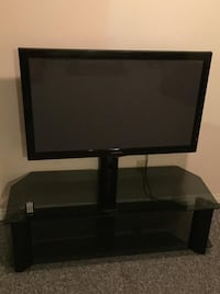 Black flat screen tv with remote London, N6E 3R8