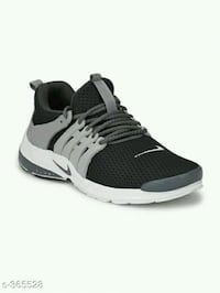 pair of black-and-white running shoes Ahmedabad, 380016