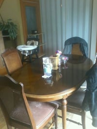 oval brown wooden dining table with chairs set Montréal, H9J 3P2