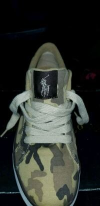 unpaired gray and white Adidas NMD Muskegon, 49442