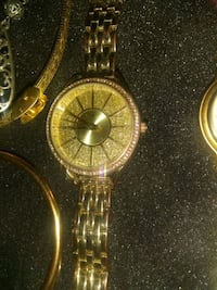 round gold-colored analog watch with link bracelet Phoenix, 85021