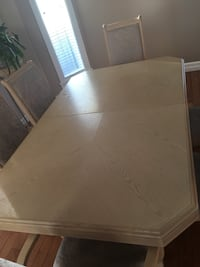 Extends wooden dining table with 6 chairs Edmonton, T5X 0A3