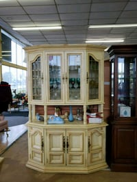 brown wooden framed glass display cabinet West Bloomfield Township, 48322