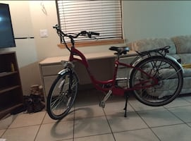 Red and black electric cruiser bike bought it for 1000 trying to sell