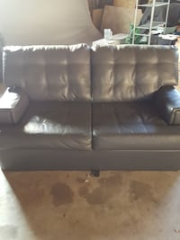 tufted black leather loveseat