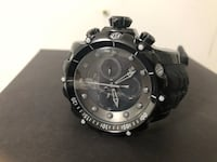 Round black chronograph watch with black strap 546 km