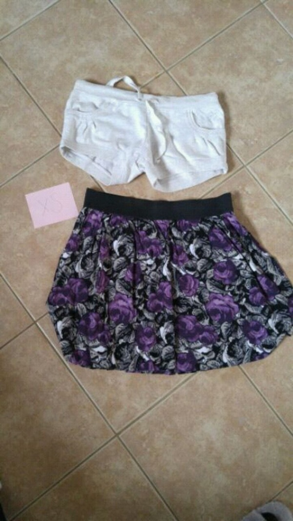 women's white short shorts and purple and black skirt