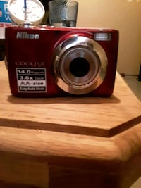 red Nikon Coolpix point and shoot camera Cleveland