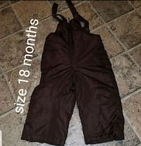 black and gray pants with text overlay 70 mi