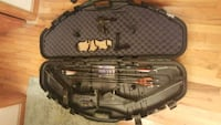 black and brown compound bow in case Asheville