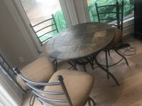 Round black metal table with four chairs patio set Mississauga, L5B 1A7