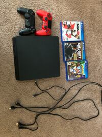 Black sony ps4 console with controller and game cases Spartanburg, 29303