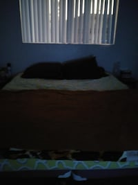 brown and white bedspread