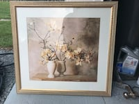 Brown wooden framed painting of flowers 56 km