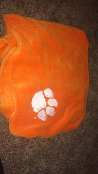 orange paw printed textile