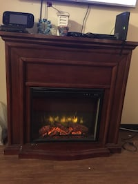 brown and black framed electric fireplace Vancouver, V5N 1P3