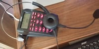 black and red digital device 1002 km