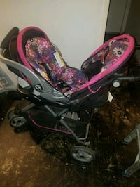white, pink, and purple floral umbrella stroller