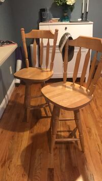 Two brown wooden windsor chairs null