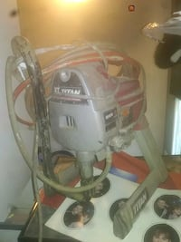 white and red Bosch canister vacuum cleaner Surrey