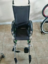 black and green wheelchair with gray metal base an 2257 mi