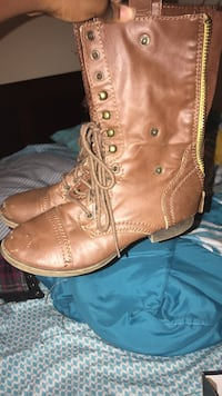 pair of brown leather cap-toe side-zip mid-calf boots