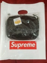 black and red Supreme backpack New York, 10463