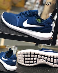 pair of blue Nike low-top sneakers New Delhi, 110064