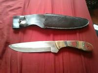 brown handled knife with leather sheath