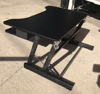 black wooden table with black metal base Los Angeles, 91335