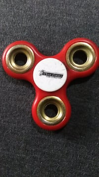 Red fidget spinner used for ADHD WASHINGTON