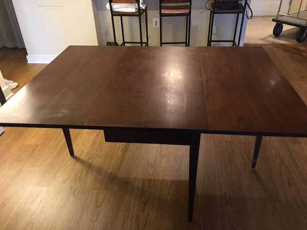 1930's drop leaf table made as a reproduction of one owned by Henry Ford. Made by Colonial Manufacturing in Zeeland, Michigan.