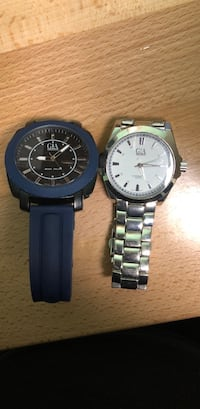 Two round silver-colored analog watches 556 km