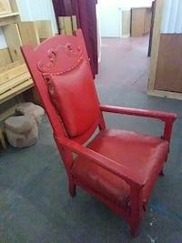 red wooden framed brown padded armchair