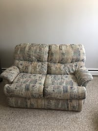brown and gray floral fabric sofa chair