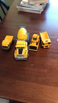 four Caterpillar cement mixer truck and dump truck die-cast models