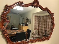 Brown wooden framed wall mirror and marble table  Kissimmee, 34758