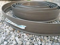 Coil of lawn edging never been used  Cambridge