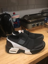 Pair of black-and-white men's shoes. Size 42. Or 7-8 here. Brand new never worn  Sherwood Park, T8A 0Y1