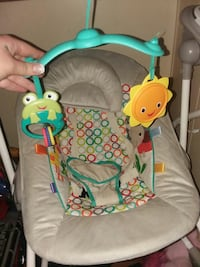 baby's gray and green electric swing