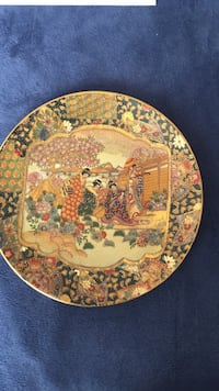 Brown and white ceramic decorative plate