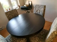 round black wooden table with four chairs dining s Montréal, H3G 1A9